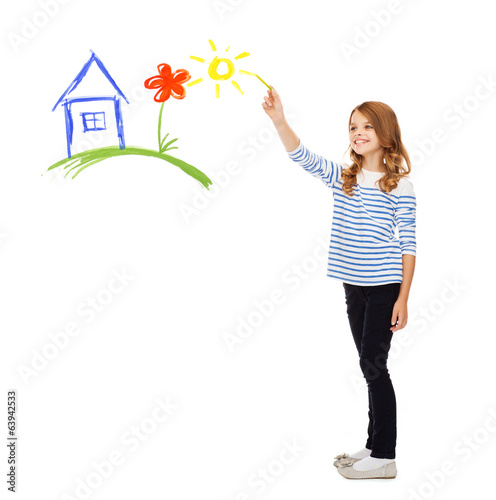 girl drawing house in the air
