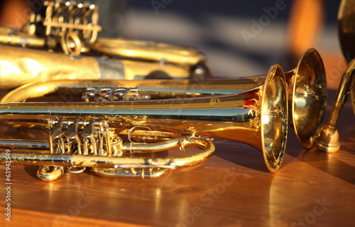 Blowing brass wind instrument on table - 63942549