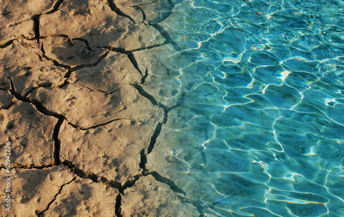 Water and dry soil in in picture - 63942726