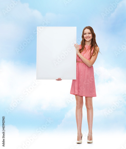 young woman in dress with white blank board
