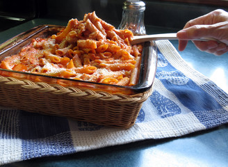 Cheesy Chicken Penne Being Served