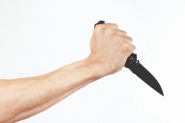 Hand with a knife on a white background