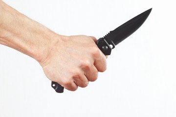Hand holding a army knife on a white background