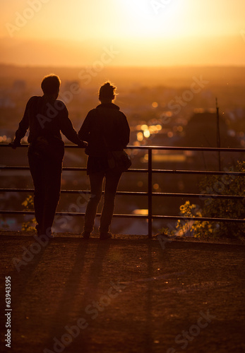 silhouette of couple enjoying sunset over Freiburg, Germany