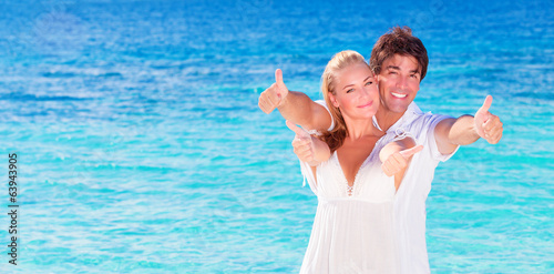 Cheerful couple enjoying beach vacation