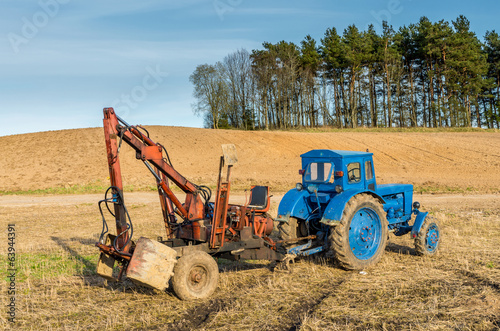 Old russian tractor with loader