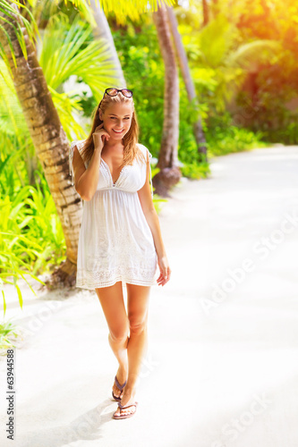 Pretty woman on tropical beach