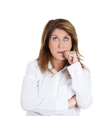 Clueless middle aged woman biting fingernail, sucking thumb