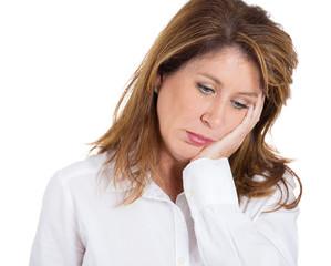 Headshot Depressed middle aged woman on white background