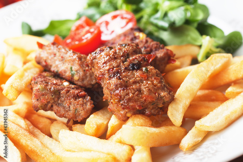 Square burgers with french fries