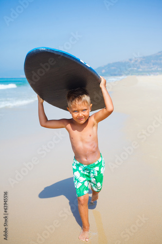 boy has fun with the surfboard