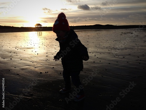 child on beach in winter