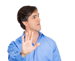 Upset, offended young man giving talk to the hand gesture