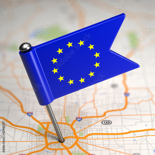 European Union Small Flag on a Map Background.