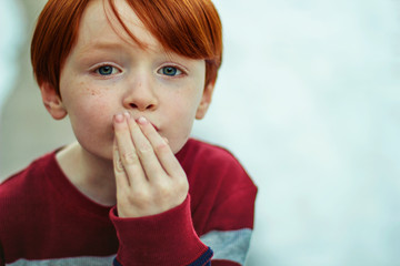 Redhead Boy Kissing His Hand