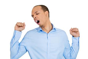 I'm tired. Sleepy yawning young man on white background