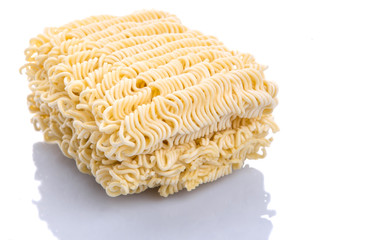 Dried instant noodles over white background
