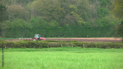 Long Shot of Tractor Ploughing Field