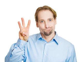 Third place. Man shows three fingers, unhappy, white background