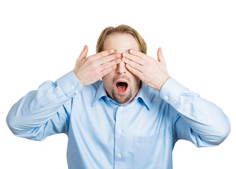 See no evil concept. Man covers his eyes avoiding conflict