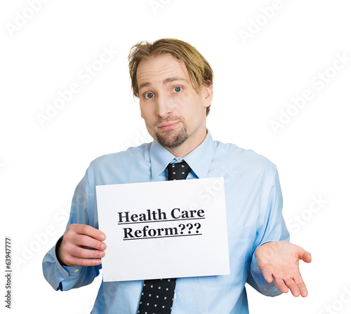 Confused man holding healthcare reform? sign