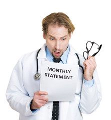 Healthcare costs. Doctor shocked by his monthly statement