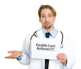Confused doctor holding Healthcare reform? sign
