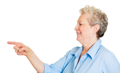 Happy senior lady point with finger, smiling, white background