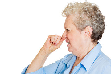 Side profile senior elderly woman disgusted something stinks