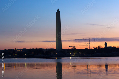 Washington Monument at dawn with city skyline.