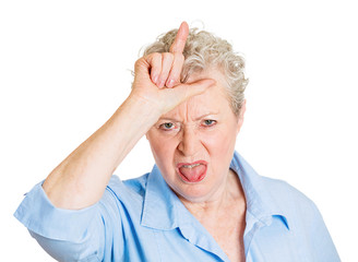 Senior mature woman showing loser hand gesture displeased