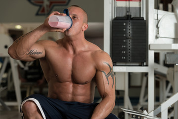 Bodybuilder With Protein Shaker