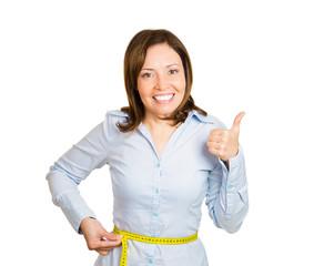Losing weight. happy woman measuring her waistline