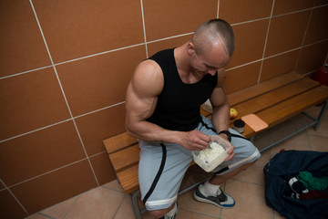 Bodybuilder Eating Healthy Diet Food Out Of Tupperware