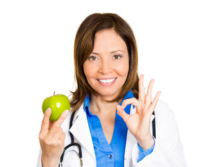 Apple a day keeps doctor away. Female physician nutritionist
