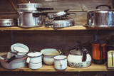 shelves cluttered with pots and pans poster
