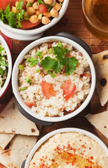 Couscous with spring onion and tomato