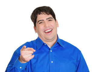 Young man pointing and laughing at you