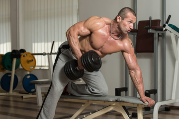 Healthy Man Doing Heavy Weight Exercise For Back