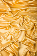 Abstract background, drapery gold fabric.