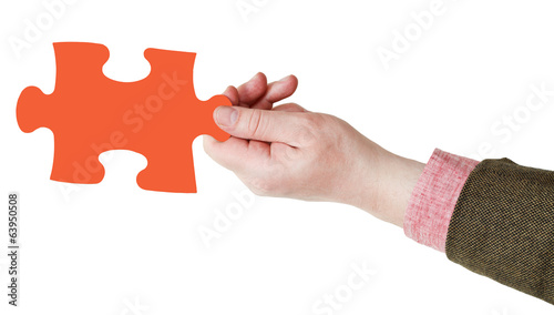 male hand with red puzzle piece