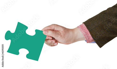 male hand with green puzzle piece