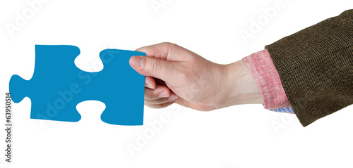 male hand with blue puzzle piece