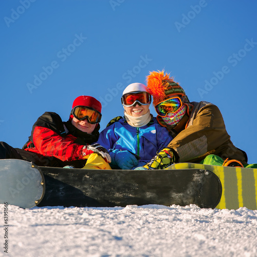 Happy snowboarding team