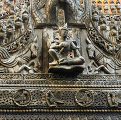 Wood carving of Lawka Nat at Shwenandaw Monastery in Myanmar