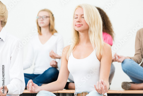 young woman, meditating with closed eyes