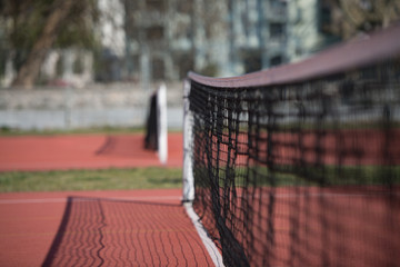 Tennis Court Net and Court Beyond