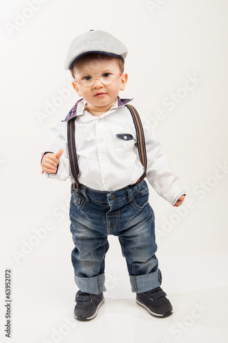 Cute boy with eyeglasses, suspenders and hat