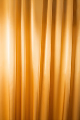 Abstract background, curtain, drapes gold fabric.