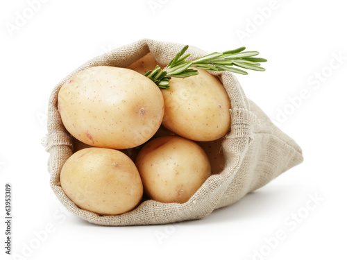 fresh young potato in sack bag with rosemary